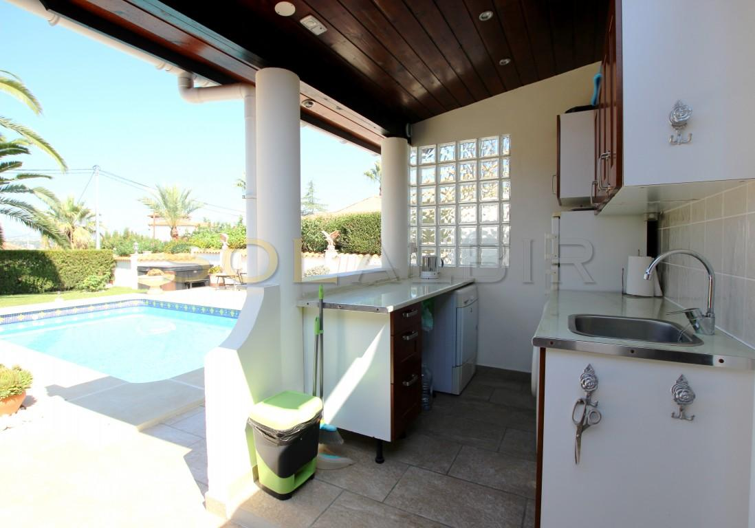 The outdoor kitchen by the pool