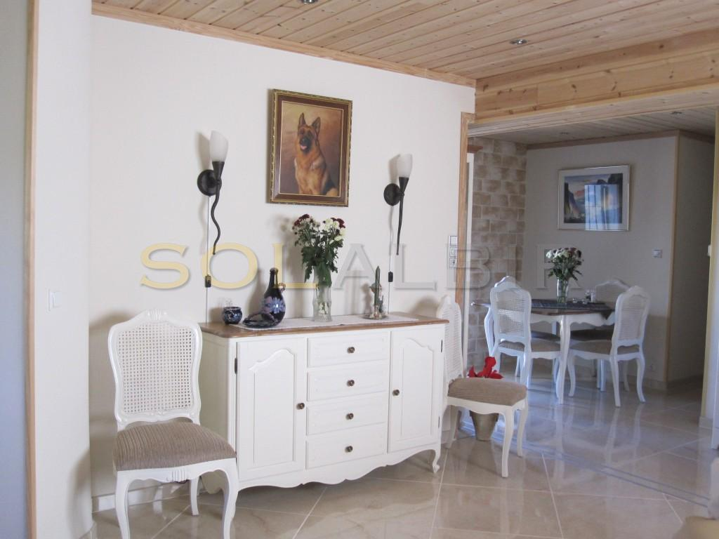 The dining area and the living room