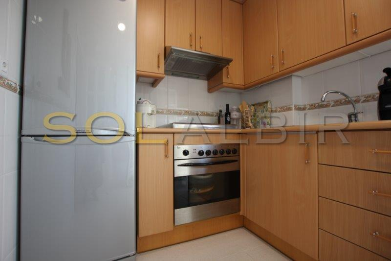 Fully equipped kitchen and cloak room with washing machine and dryer