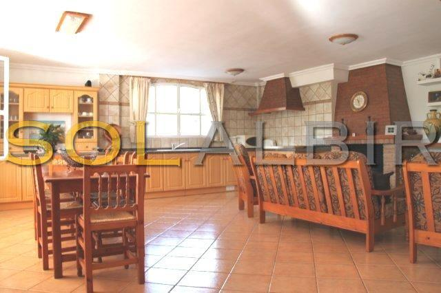 Second kitchen with living room and chimney