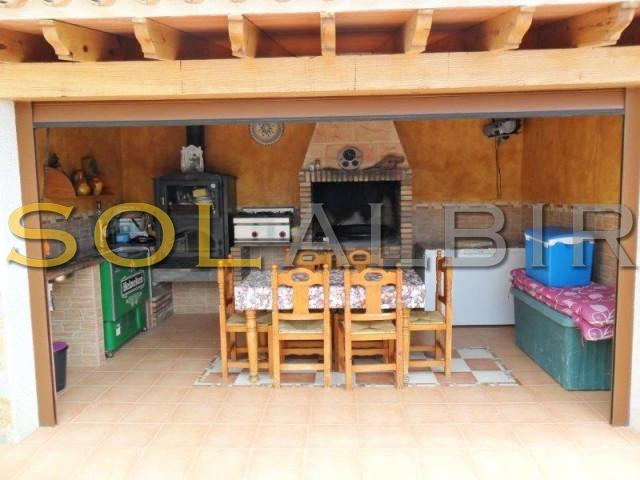 Summer kitchen with barbecue and oven