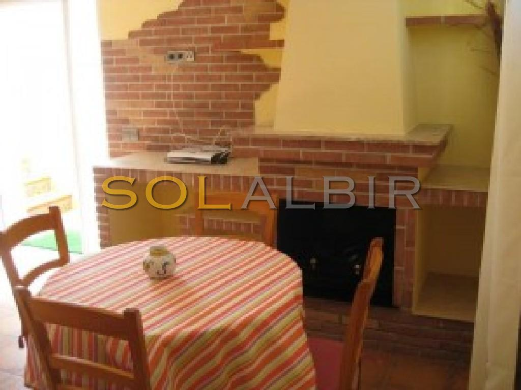 The dining and the fireplace in apartment