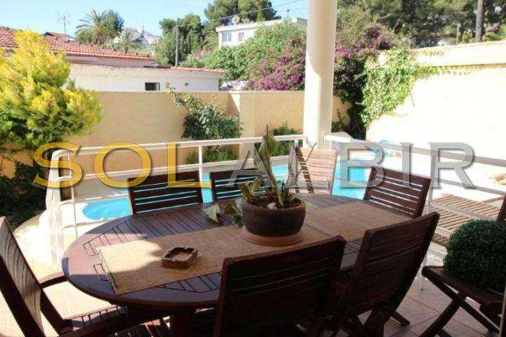 Covered terrace with access to the pool area