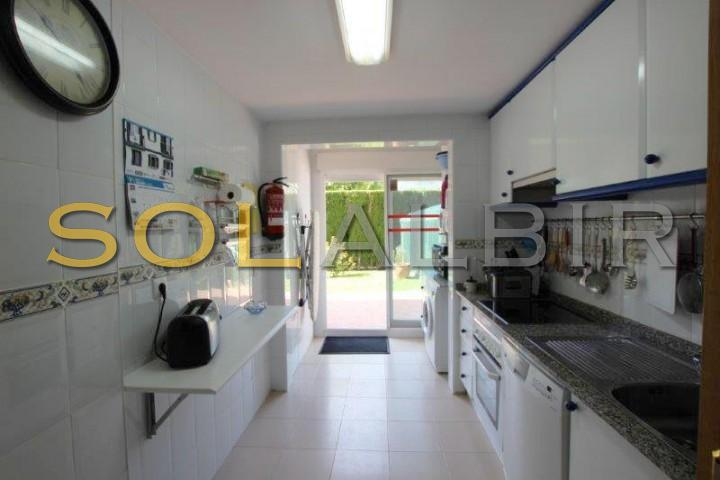 Kitchen with laundry and access to the terrace