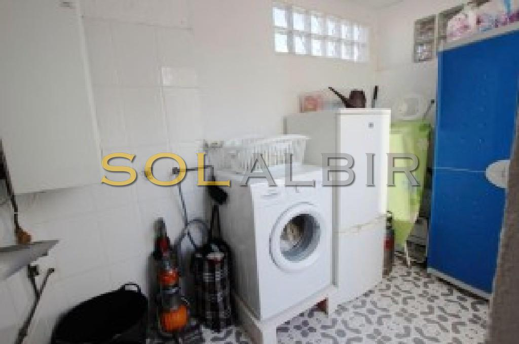 Laundry room next to kitchen