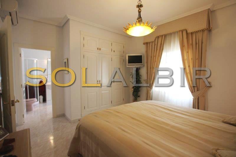 with wardrobe and a bathroom en suite