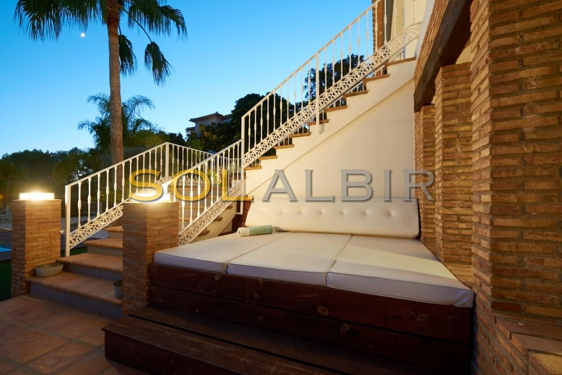 The stairs down to the pool and garden area